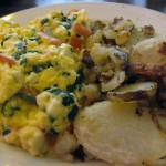 Eggs scrambled with feta, spinach, scallions and tomatoes