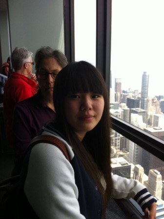 Deb hiding behind Kanari at Sears Tower