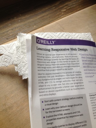 Learning Responsive Web design, interleaved for drying. I guess I learned some stuff in my preservation courses in library school. It's only paper towel, and will leave a crinkle pattern on the pages, but at least I'll be able to read them.
