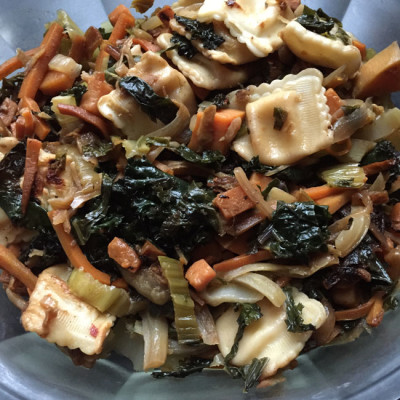 Cultural mashup bottom of the vegetable bin stirfry with onions, sweet potato, carrots, ginger, soy sauce & sesame oil and garlic, and kale and bok choy - and baby Parmesan cheese ravioli
